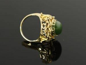 14 karaat gouden ring met mooie groene edelsteen en pareltjes aan de andere zijde/reverso ring/beide zijden te gebruiken.