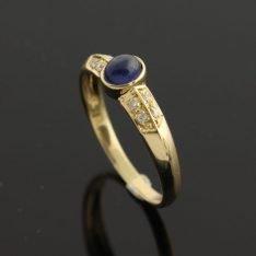 Prachtige 14 karaat gouden ring met briljant en saffier. (gereserveerd)