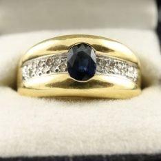 14 karaat gouden ring met saffier en briljant.