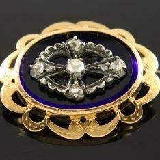 14 karaat gouden broche met briljant op lapis lazuli.