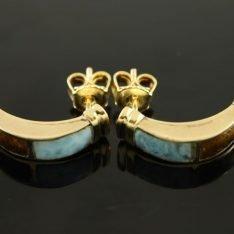 14 karaat gouden oorbellen met larimar en barnsteen.