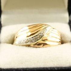 14 karaat gouden tricolor ring met briljant.