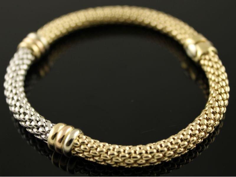 14 karaat gouden bicolor armband met bijzondere (flexibele-slangenhuid-motief) schakel.