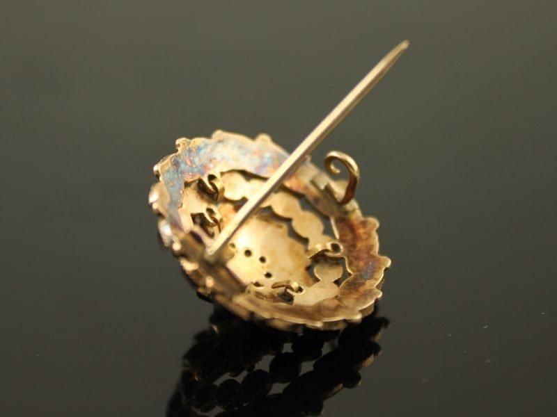 14 karaat gouden broche met granaat.